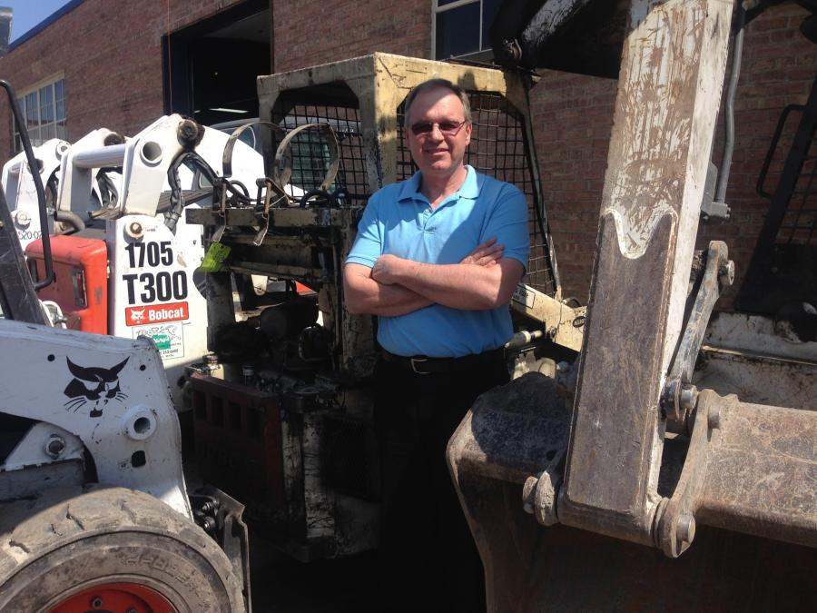 Bob Loula in front of an old M610 Bobcat that was in for repair. Loula originally sold this machine to this customer in 1979 and the customer is still using it!