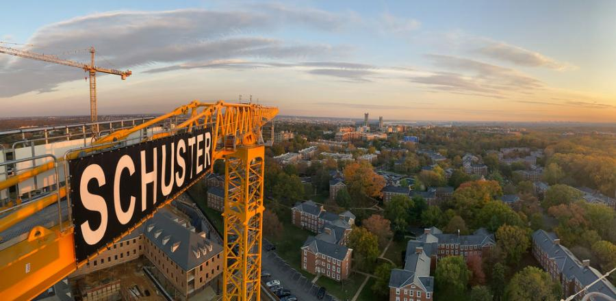 The crane's 214 ft. (65 m) height and 9.1 ton (8.2 t) capacity at 262 ft. (79.8 m) reach, combined with a 27.6 ton (25 t) max capacity, enables Schuster to perform lifts over the historic building that is currently on the property, assisting the construction of the other buildings that will be on the site.