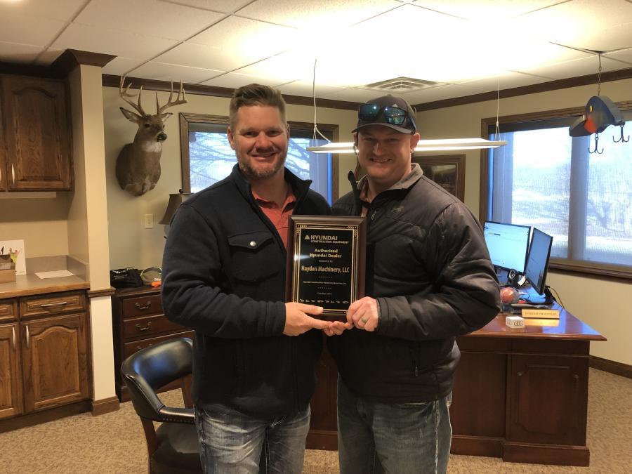Justin Hayden (L), owner of Hayden Machinery, and James Thompson, sales manager of Hayden Machinery.
