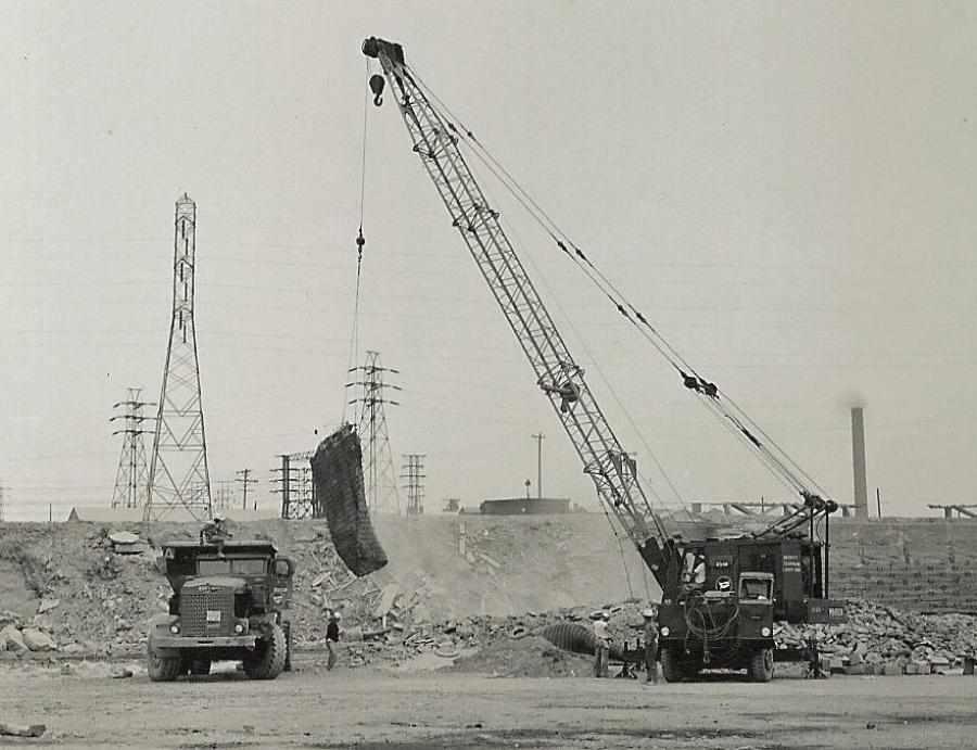 On August 15, 1959, sixty years ago, Merritt-Chapman & Scott is using a Marion 43-M truck crane to pick a blasting mat during construction of the Niagara Power Project. The hauler is one of some 120 R22 and R27 Euclids and PH95 Payhaulers M-C&S massed to handle nearly 17 million yds. of rock excavation on two contracts to construct the power plant, intake structure and two conduits. The mat is placed over a small blast to contain debris. (Marion Power Shovel Company photo, HCEA Archives)