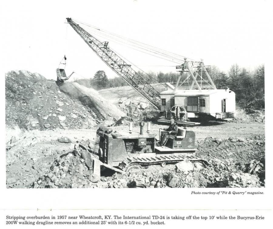 Stripping overburden in 1957 near Wheatcroft, Ky., the International TD-24 is taking 10 ft.off the top while the Bucyrus-Erie 200W walking dragline removes an additional 25 ft. with its 6-1/2 cu. yd. bucket. (Pit & Quarry Magazine photo, HCEA Archive)