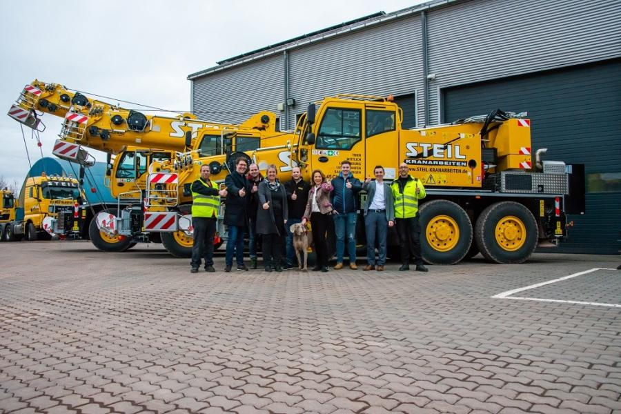 (L-R) are Stephan Blum, yard manager; Daniel Gödert, company officer; Markus Blum, field Service; Gabriele Marx, scheduling; Tobias Clodo, Scheduling; dog Nivo, Dunning Management; Birgit Steil, managing director; Niclas Kany, scheduling; Frank Nicklas, branch manager; and Lars Stephany, City Crane operator.