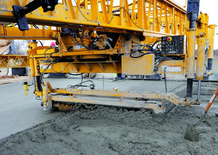 GOMACO's screed has an auger, finishing cylinder and trailing screed to finish concrete in one pass. It also is capable of advancing up to 4 ft. (1.2 m) in a single pass.