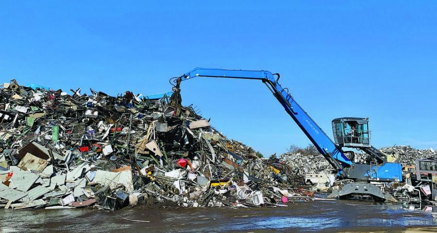"""An operator uses a Fuchs MHL350 at Allied Recycling Center to sort through a pile of material. """"We chose the 350 because it has the right reach for the yard,"""" President Eddie Jamieson said. """"The arm can extend 50 ft., and the cab has a continuously variable viewing height of up to 18 ft., which gives the operator a bird's-eye view of the yard."""""""