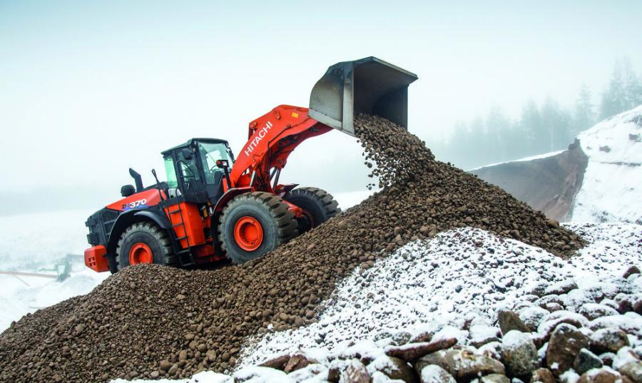 The large Hitachi ZW370-6 wheel loader features 48,780 lbs. of breakout force, a bucket capacity range of 7.3 to 8.1 cu. yd. (5.5 to 6.2 cu m), and is powered by a 389 hp Isuzu Tier IVF engine (DPF-free).