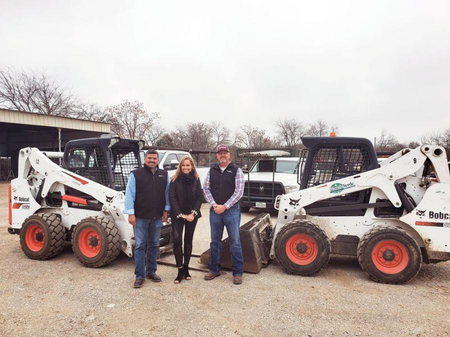Susanna Guzman, co-owner of Mundo Verde Landscaping, is flanked by her husband and partner Carlos Palos (L) and Bobcat of San Antonio representative David Moravits. Moravits has been the couple's link to the Bobcat brand for more than a decade.