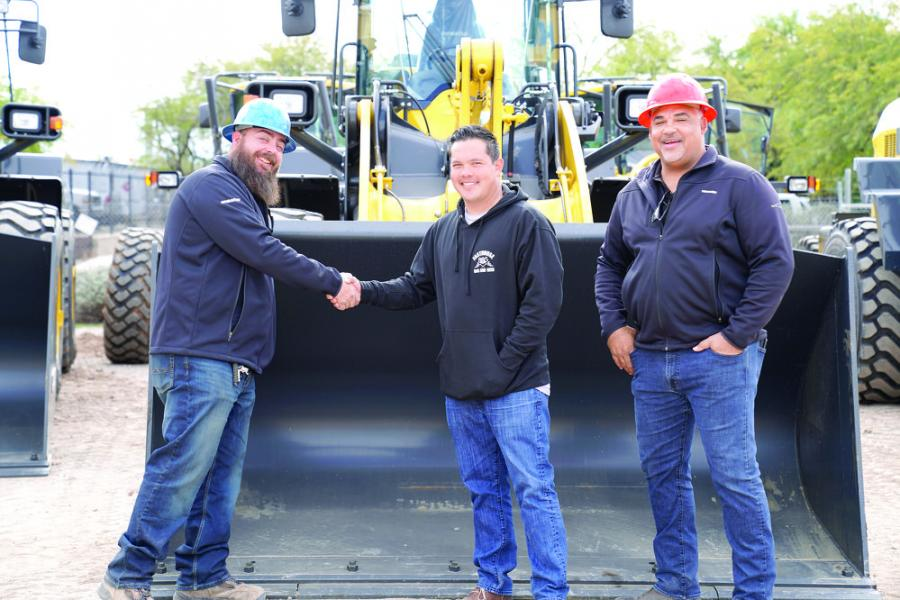 Sam Papanikolas, owner of Dirtworks who recently purchased 13 new Komatsu machines to add to his fleet, stands with Road Machinery Product Support Representative Josh Smith (L) and Sales Account Manager Earl Stagger (R).