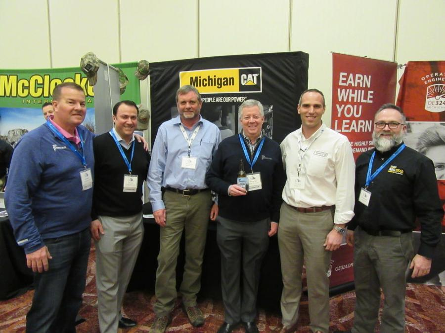(L-R): Scott Weaver and Eric Evans of Corrigan Oil Company; Michigan Cat's Ken Anderson; Mike Corrigan of Corrigan Oil Company; and Tony Marulli and Ken Meerschaert of Michigan Cat caught up at the show.