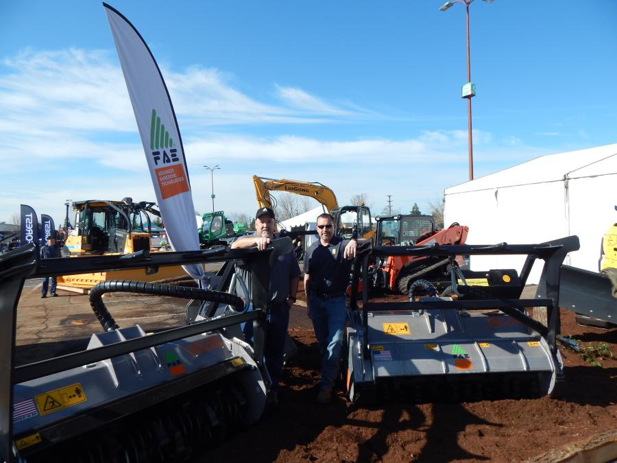 FAE, land-clearing products out of Flowery Branch, Ga., Territory Manager Dan Crow with Product Manager Lee Smith at the Pacific Tractor, Hillsboro, Ore., booth.