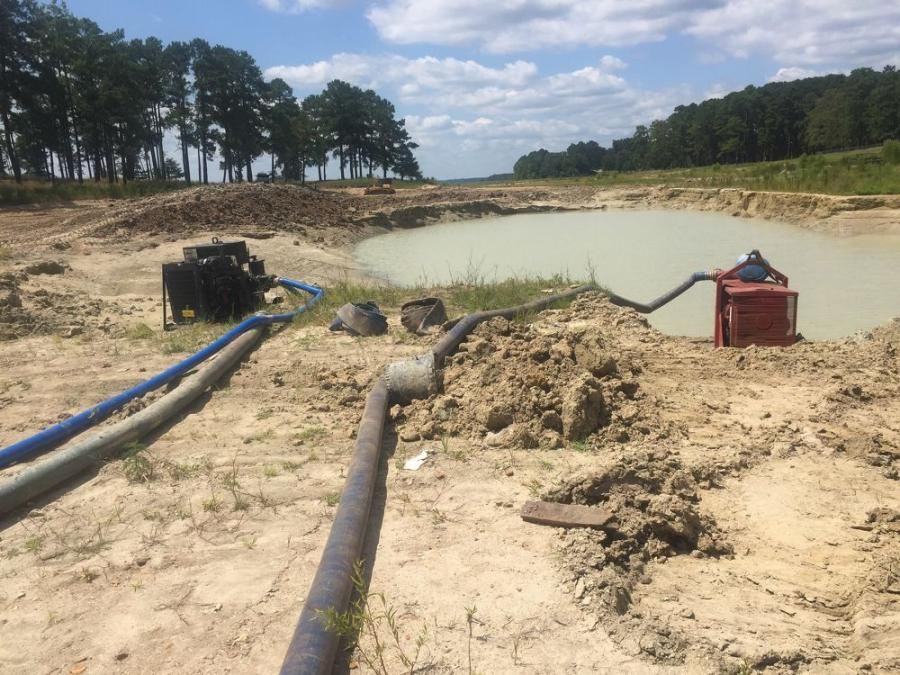 Pumping water out of the spillway approach channel scour hole