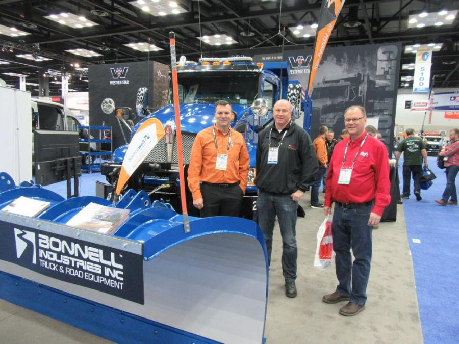 (L-R): Bonnell Industries' Joe Bonnell spoke with Joe Judge of the city of Mt. Carmel and Jim McLaughlin of Bert's Truck Equipment of Moorhead about the company's snow and ice control, road maintenance, leaf vacuum equipment as well as truck up-fitting and service capabilities.