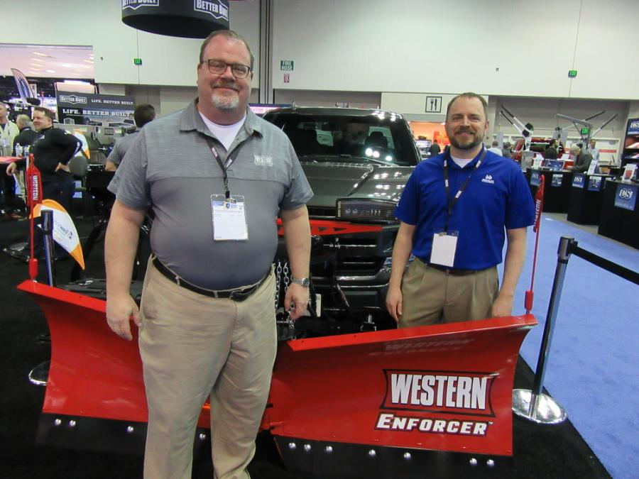 Western Products' Doug Clark (L) and Seth Bergerud of Douglas Dynamics present the all-new Western Enforcer V-plow.