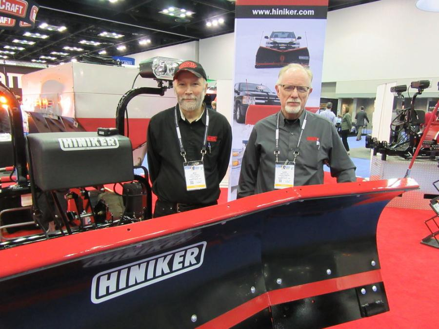 Mike Zimprich (L) and Mark Miller of the Hiniker Company welcome attendees to review their display of snow and ice maintenance equipment.