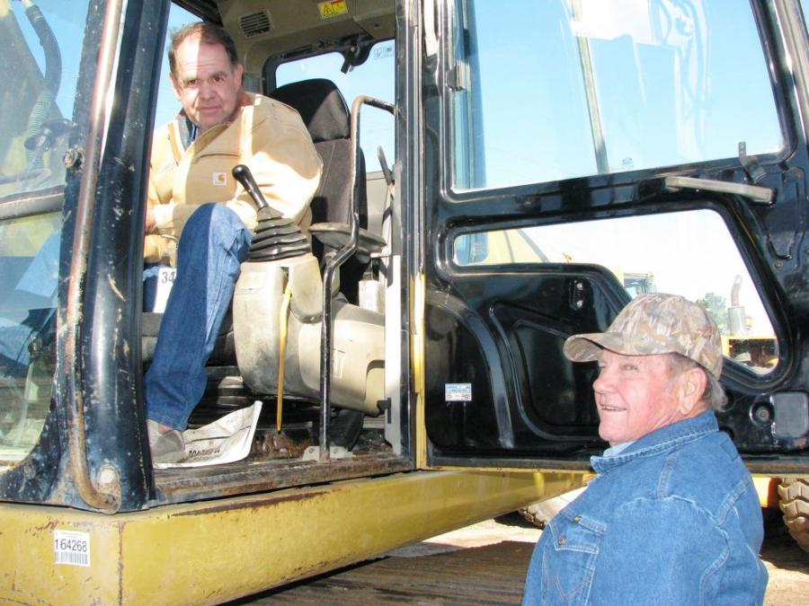 Discussing the operation of a Caterpillar 324DL excavator are Mark Emfinger (L), Tech Contractors, Baskin, La., and Johnny Browning, an independent contractor based in Winsboro, La.