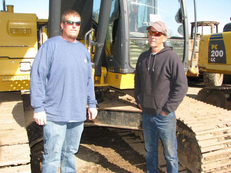 Discussing their individual excavator inspections are Charles Bourgeois (L) and Owen Kosbab of Bourgeois Trucking & Equipment, Waveland, Miss.