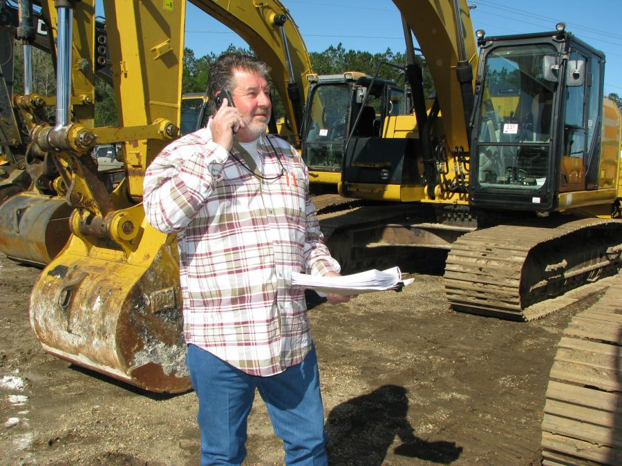 Phoning for more info on an excavator purchase consideration is Larry Moore of Moore Brothers Truck & Trailer Sales, Tyler, Texas.