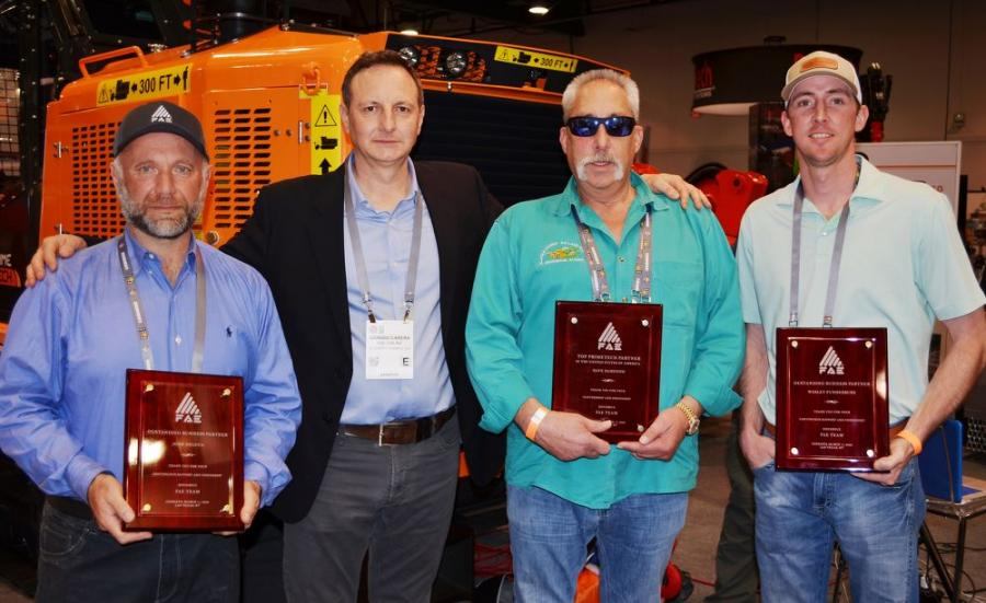 Individual awards for purchases of FAE products were presented to (L-R): John Deluca, owner, ADeluca Paving and Reclamation; Giorgio Carera, CEO, FAE USA; Dave DeMenno, owner, Alaska Hydro-ax; and Wesley Funderburk, owner, Re-gen Earth Solutions.