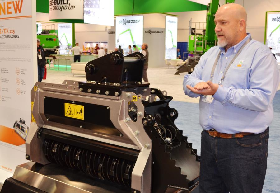 Product support manager Lee Smith goes over the new BL1 and BL2 series of excavator mulching heads during the press conference.