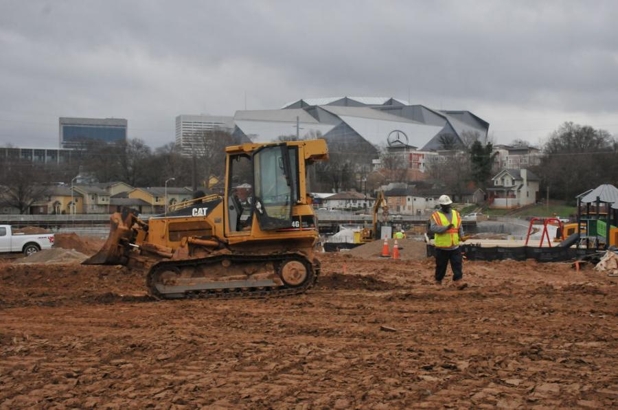 In the shadow of Mercedes-Benz Stadium, home to the NFL's Atlanta Falcons, Astra-Rohadfox's Cat D4G dozer assists in site prep work for the city's new 16-acre park.
