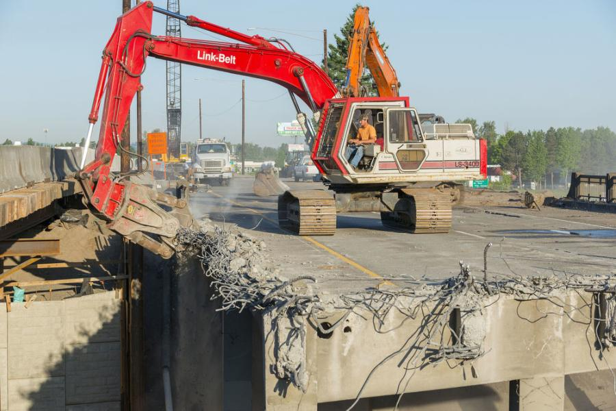Excavators are key to the demolition and construction of the new bridge.