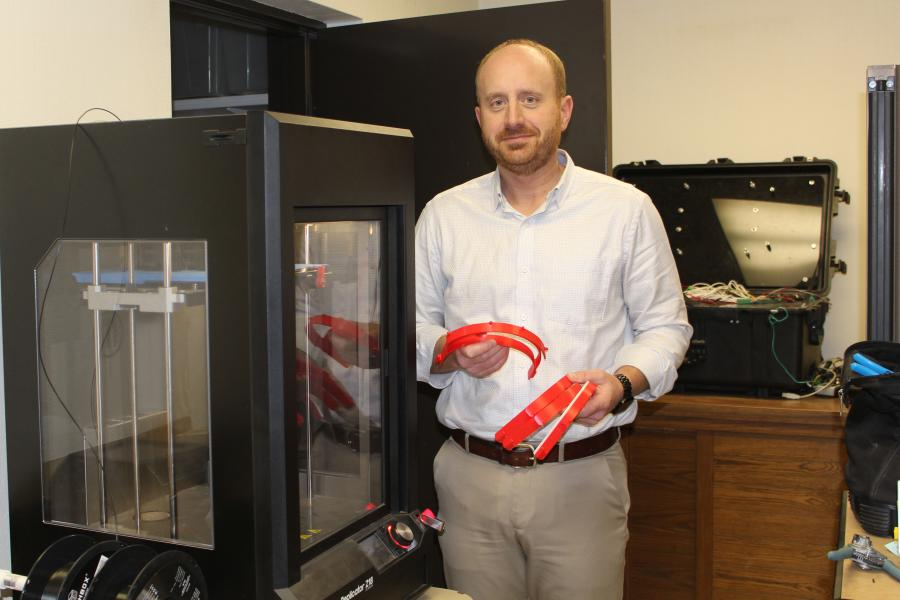 Terex team members print parts for face shields produced on the company's 3D printer.