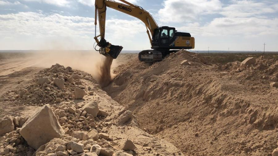 MB-HDS320 - Kobelco SK300LC  performs utility work on soil and rocks.