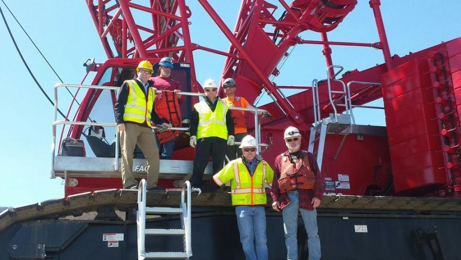 Hoffman President Tim Watters and N.Y. Crane Specialist Pat Tomasetti deliver a new MLC 300 to Tappan Zee Constructors on the Mario Cuomo Bridge.