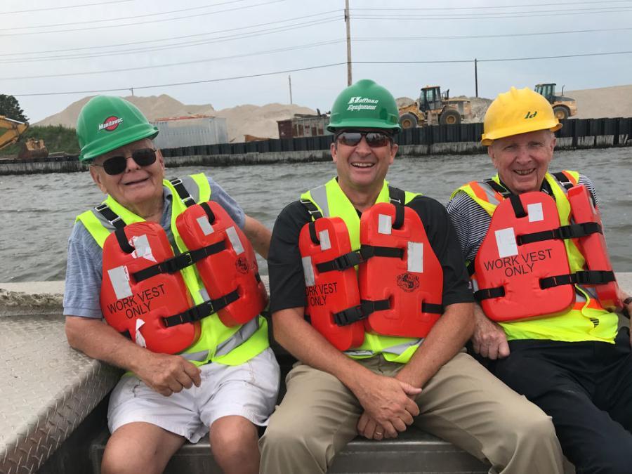 "(L-R): Three Hoffman generations: Harry ""Jim"" Hoffman, Tim Watters and Joe Watters tour a bridge job from a customer's work boat."