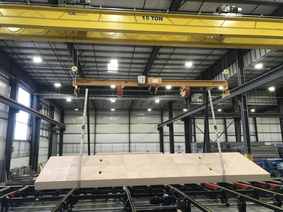 The 22,500-lb. (11.25-ton) capacity Caldwell Posi-Turner gets to grips with another plywood panel.