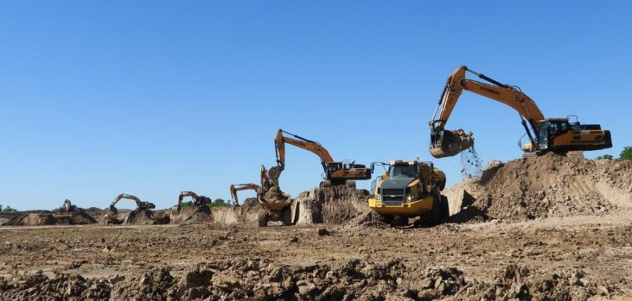 There are 21 Bell off-road dump trucks on the site, along with seven Hyundai 480 excavators and 10 dozers.
