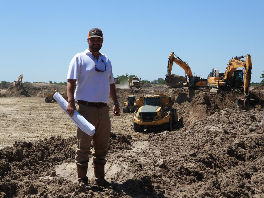 Brittain Griffith, owner of Sonora Construction in Houston, checks on progress at the Bridgeland subdivision site. Story on page 40.  Sonora is moving 2.4 million cu. ft. of dirt to create a 4-mi.-long string of lakes in the Howard Hughes Company development.