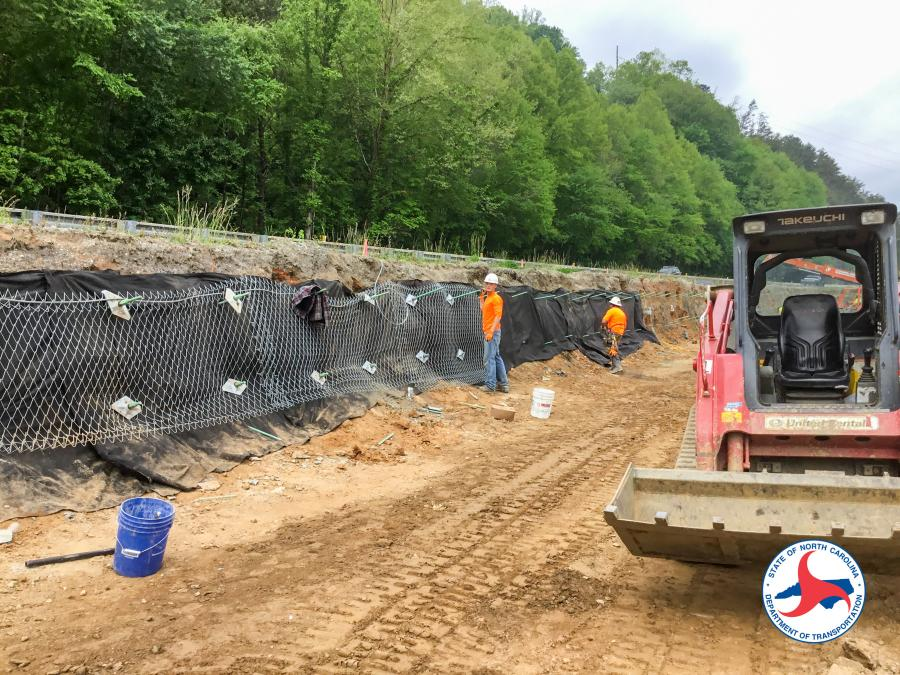 The $4.9 million construction project includes removing a portion of the existing road, digging down 20 ft. to remove material, and building a retaining wall in the cavity to support the existing lanes.