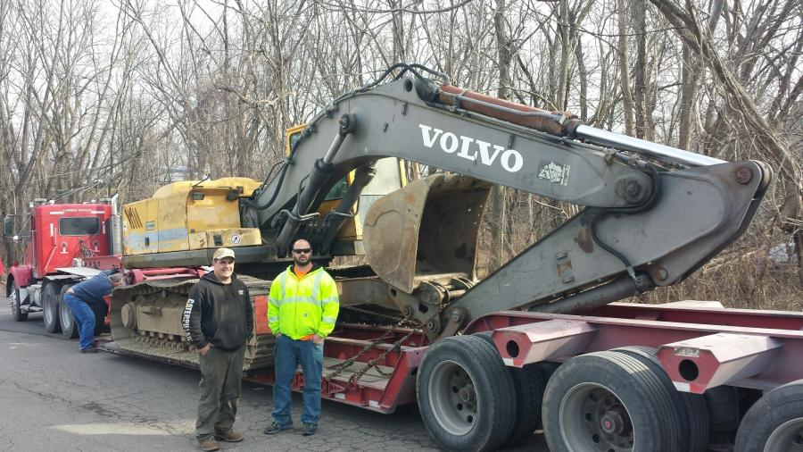Mike Randazzo and Louis Sanzaro with their Volvo excavator, one of the centerpieces of their equipment fleet.