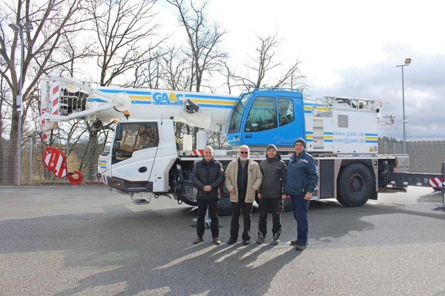 Yet another Tadano from Lauf an der Pegnitz for GAAC. (L-R) are Uwe Degenhardt, Tadano area sales manager, with Peer Vogel, managing director of GAAC Commerz GmbH, and two of his colleagues.