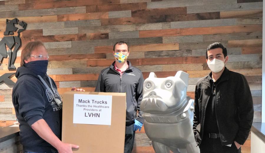 LVO employees William Kulnis (L) and Karan Arora (R) presented face shields to Lehigh Valley Health Network representative Adam Selmasska.