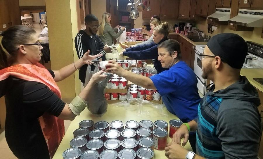SCRC members assemble Hound Packs, which are weekend meals for youth in the Shippensburg Area School District. (Archive photo from 2019)
