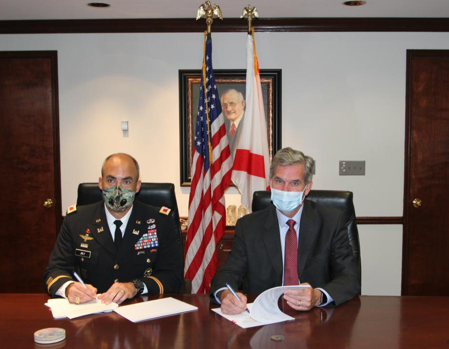 Col. Sebastien Joly (L) and John Driscoll, director and CEO of the Alabama State Port Authority, sign the project agreement to take the Port of Mobile to 50 ft. (Alabama Port Authority photo)