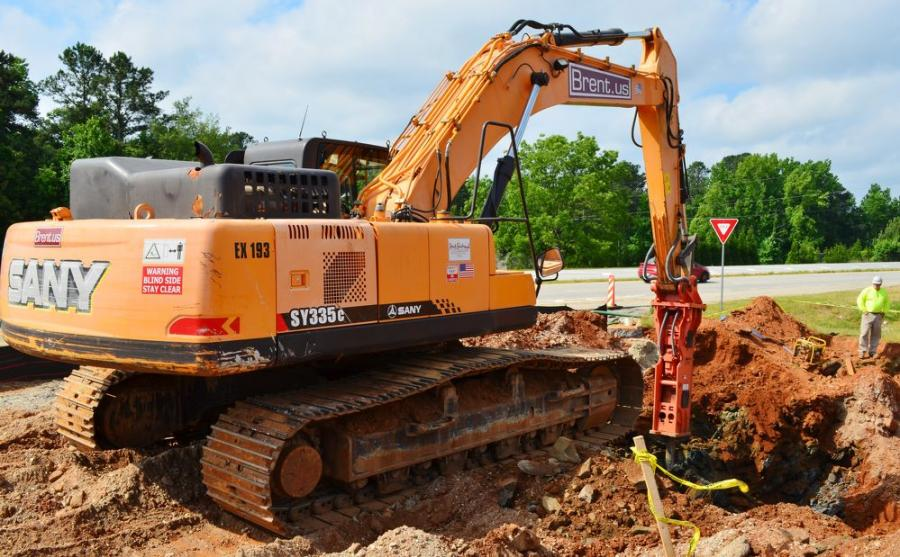 A SANY SY335 C works next to a highway in Dallas, Ga., at a clearing site for Brent Scarbrough & Co.