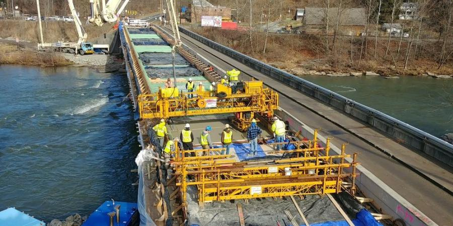 Prime contractor Plum Contracting Inc. used a Terex Bid-Well finishing machine. The challenge was to finish the concrete deck surface to the specified longitudinal and transverse grades. Once set up to do so, the Bid-Well automatically finished the deck surface to the desired grades.