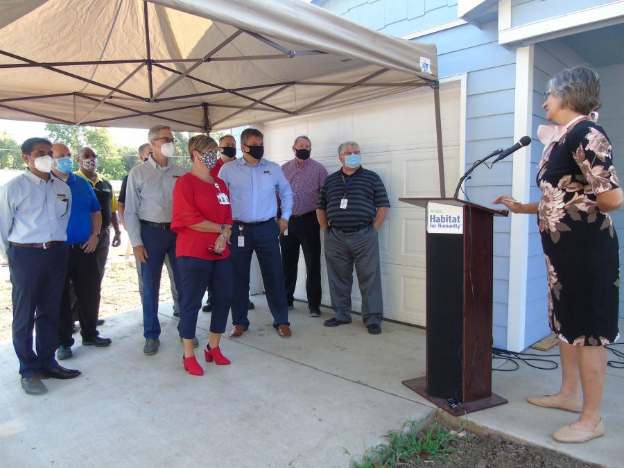Ann Fox, of Habitat Wichita, welcomes guests.
