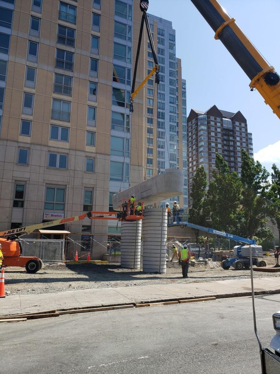 This summer, massive precast concrete pier caps were lifted into place atop new support columns on the Lechmere Viaduct transit construction project across the Charles River in downtown Boston.