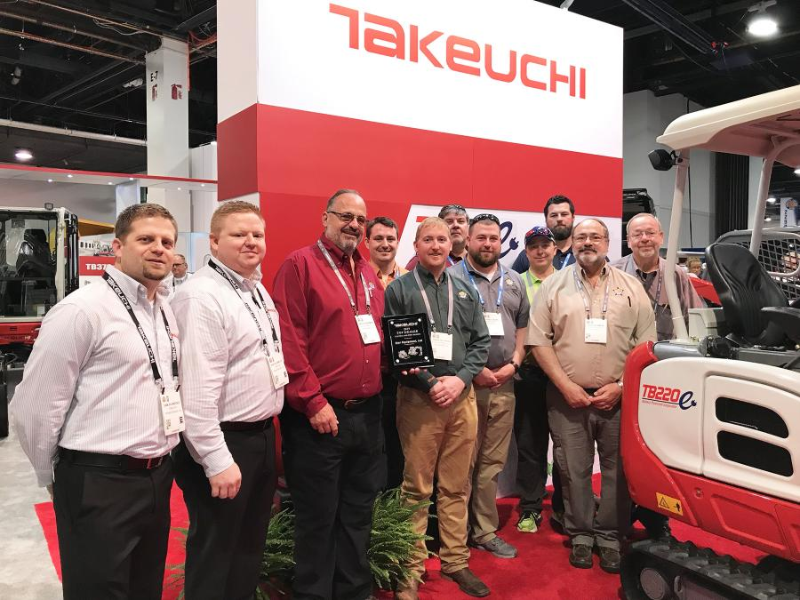 (L-R) are Sam Schneider, Takeuchi Central Midwest regional product manager; Shay Klusmeyer, Takeuchi Central Midwest regional business manager; Bruce Bowman, president of Star Equipment; and Kevin Arens, Remington Lawyer, Scott Thompson, Jared Vaske, Wade Snyder, Mitch McDonough, Brad Bowman and Brett Bowman, all of Star Equipment.