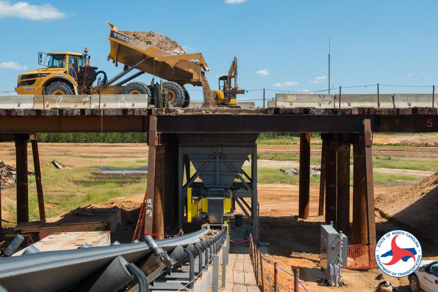 An innovative effort in delivering this phase of the Fayetteville Outer Loop project is the use of a conveyor belt system to efficiently transport fill material.