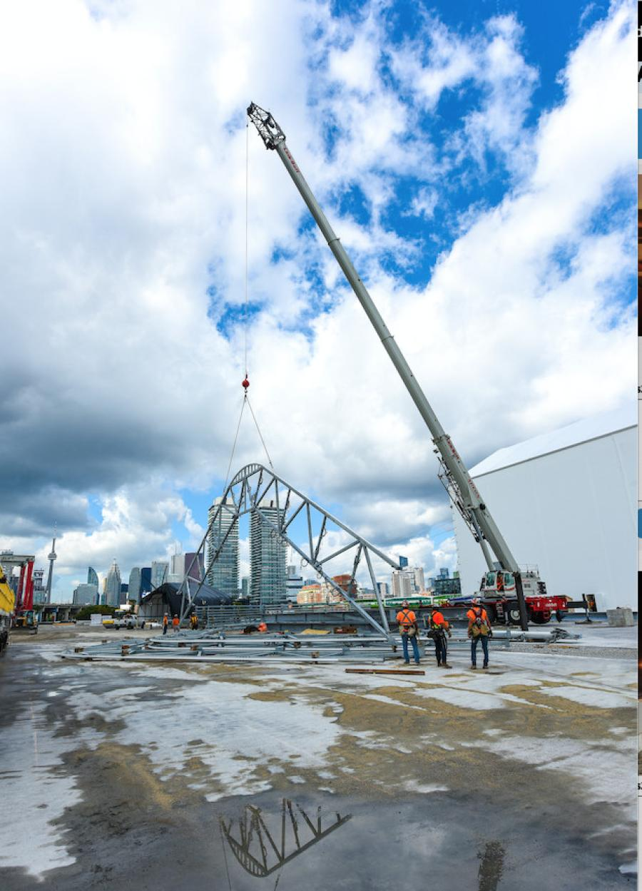 Two 160-ton (145-mt) Link-Belt RTC-80160 Series II rough terrain cranes lift and remove existing steel and concrete expressway deck sections and replace with new fabricated deck panels.