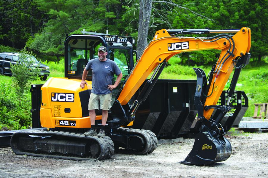 Jason Shiers, owner of Pleasant Hill Property Services, with his new JCB 48Z excavator.