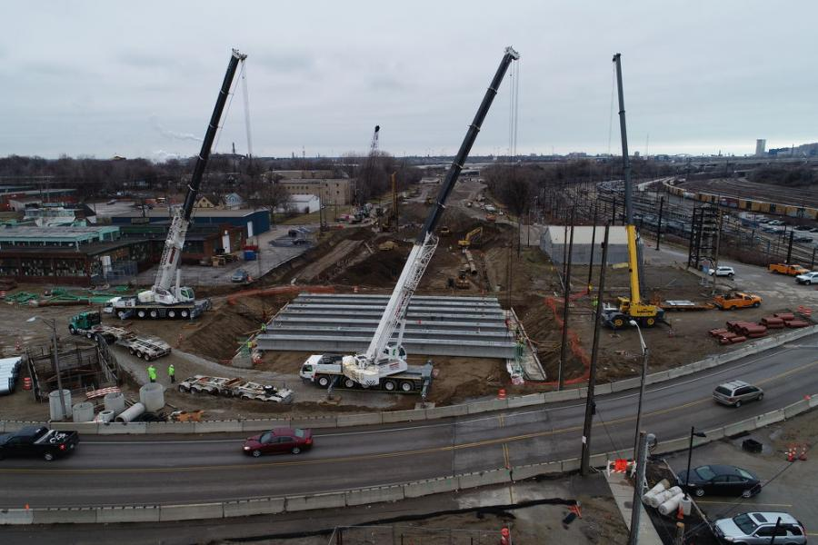 In early March 2020, crews set all eight beams for the new East 55th Street bridge over the new boulevard using top down construction. Solider pile lag wall construction for a future retaining wall can be seen in the background. This also is top down construction. (Ohio Department of Transportation photo)