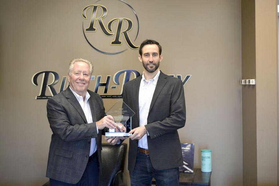 Dewey Pearman (L) presents the Highway Contractor of the Year Award to Reith-Riley Construction's Ron Foreman.