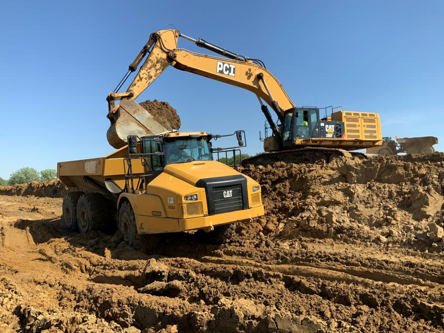 Caterpillar 390F excavators are used to load trucks, while Caterpillar 740 articulating trucks are needed to move the material. (Weber Group photo)