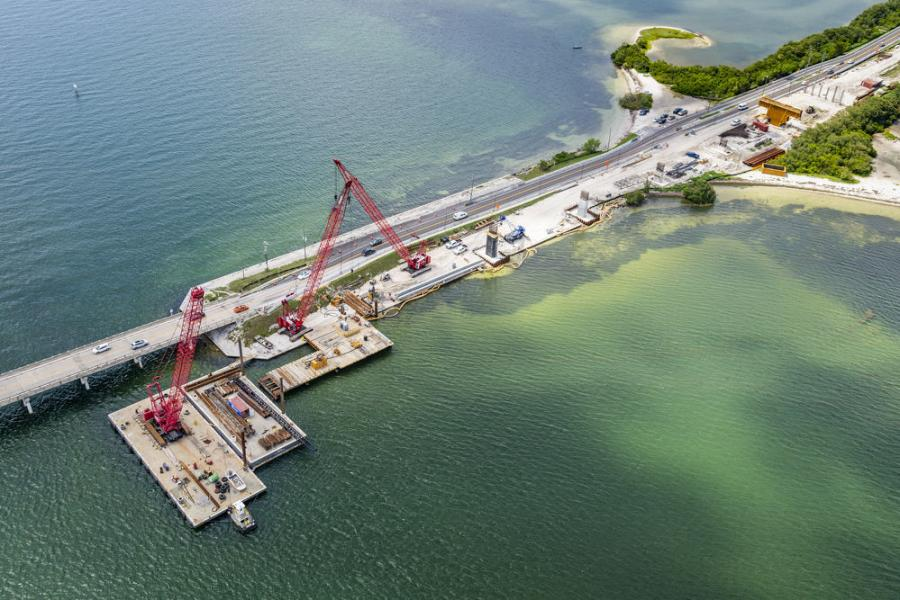 The construction site for the Florida Department of Transportation's $56.3 million project to replace the SR 679/Bayway Bridge is a hive of activity with crews and equipment from American Bridge Company.