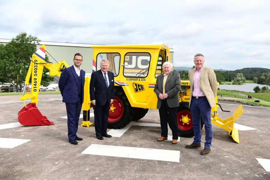 (L-R) are George Bamford, Lord Bamford, Roland Carnaby and Roland Carnaby Junior, pictured with the newly-restored machine.